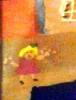 a tiny portrait of me, made when I was 5 poster paints on paper